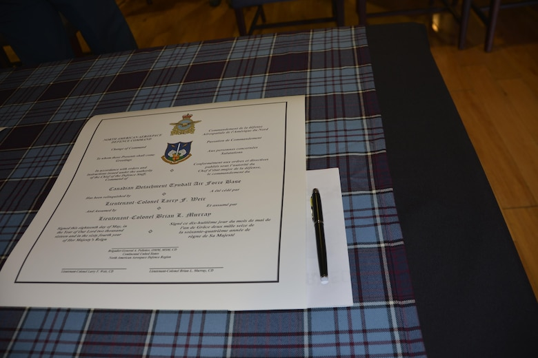 A copy of the Canadian Detachment Change of Command order awaits signature prior to the change of command ceremony May 18. Three copies of the order are presented during the ceremony for signature by the outgoing commander, the Continental U.S. Aerospace Defense Region deputy commander and the new commander. (Air Force Photo released/Mary McHale)
