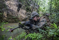 U.S. Marine Lance Cpl. Justin D. Enger sets up a security perimeter while the rest of his platoon rappels down the mountain at the Jungle Warefare Training Center, May 19, 2016 at Camp Gonsalves, Okinawa, Japan. Enger is a combat engineer with 9th Engineer Support Battalion, 3rd Marine Logistics Group, III Marine Expeditionary Force. Enger and his platoon attended the 5-day Course at JWTC. The course gives Marines the skills to shoot, move and communicate within a jungle environment.