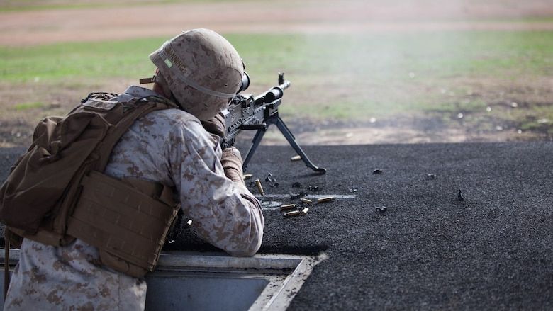 Cpl. Zachary Banning, a competitor with the Marine Corps Shooting Team, fires an M240B during the section match May 17, 2016 at Puckapunyal Military Area, Victoria, Australia. The event is part of Australian Army Skill at Arms Meeting 2016, a competitive marksmanship event that evaluates the shooting skills of the competitors. The section match consisted of two running portions and two firing portions where teams were evaluated on both skill and swiftness as a marksman.