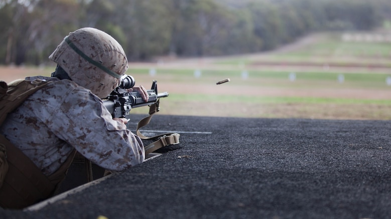 Sgt. Jose Arroyo, a competitor with the Marine Corps Shooting Team, fires his M16A4 service rifle during the section match May 17, 2016 at Puckapunyal Military Area, Victoria, Australia. The event is part of Australian Army Skill at Arms Meeting 2016, a competitive marksmanship event that evaluates the shooting skills of the competitors. The section match consisted of two running portions and two firing portions where teams were evaluated on both skill and swiftness as a marksman.