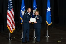 Col. Gerald Szybist, commander of the U.S. Air Force Academy Preparatory School, and Lt. Col. Samantha Weeks, guest speaker at the Prep School graduation ceremony May 24, 2016 in Arnold Hall, show-off Week's Prep School graduation certificate from 1993. Weeks was the guest speaker at the graduation ceremony. She's a 1997 graduate of the U.S. Air Force Academy, fighter pilot, and an Academy fellow. (U.S. Air Force photo/Liz Copan)