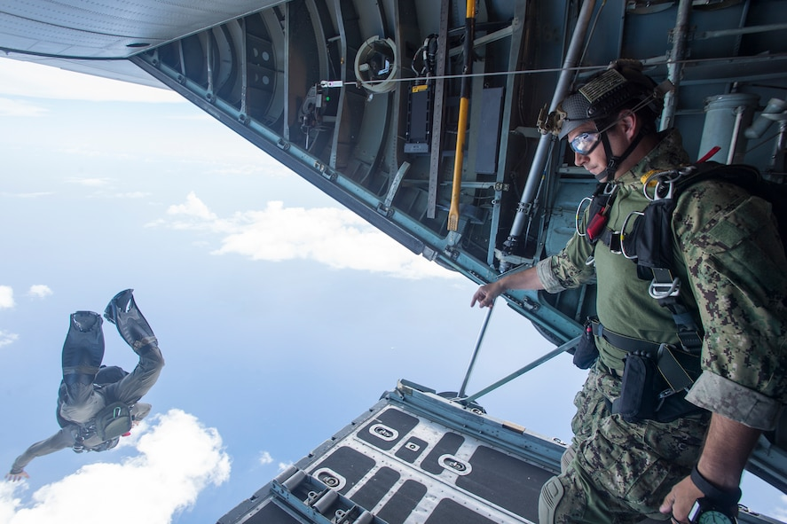 A sailor performs a free fall jump from a C-130 Hercules aircraft.