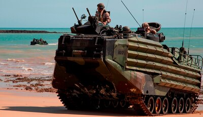 "U.S. Marine Corps Amphibious Assault Vehicles, assigned to the 31st Marine Expeditionary Unit, come ashore at Fog Bay, Australia, during exercise Talisman Sabre. The Navy engineers developing a new Extreme Power Internal Combustion (EPIC) engine to transform Amphibious Combat Vehicle (ACV) capabilities were recognized for their EPIC innovation in the Naval Surface Warfare Center Dahlgren Division (NSWCDD) annual awards program, May 18. EPIC is designed to increase power and reduce weight to achieve high water speed for future Marine Corps ACVs.  The engine's fuel efficiency can also support long term ACV ground operations. EPIC inventor, Greg Buchanan, and developer, Vincent Vendetti, were among a team of engineers winning the Naval Sea System Command 2016 Commander's Innovation Award for the innovation. ""An amphibious combat vehicle featuring the efficient, high-power EPIC engine would meet all challenges and outmaneuver future rivals to truly transform amphibious assault missions,"" said Vendetti."