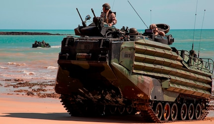 """U.S. Marine Corps Amphibious Assault Vehicles, assigned to the 31st Marine Expeditionary Unit, come ashore at Fog Bay, Australia, during exercise Talisman Sabre. The Navy engineers developing a new Extreme Power Internal Combustion (EPIC) engine to transform Amphibious Combat Vehicle (ACV) capabilities were recognized for their EPIC innovation in the Naval Surface Warfare Center Dahlgren Division (NSWCDD) annual awards program, May 18. EPIC is designed to increase power and reduce weight to achieve high water speed for future Marine Corps ACVs.  The engine's fuel efficiency can also support long term ACV ground operations. EPIC inventor, Greg Buchanan, and developer, Vincent Vendetti, were among a team of engineers winning the Naval Sea System Command 2016 Commander's Innovation Award for the innovation. """"An amphibious combat vehicle featuring the efficient, high-power EPIC engine would meet all challenges and outmaneuver future rivals to truly transform amphibious assault missions,"""" said Vendetti."""