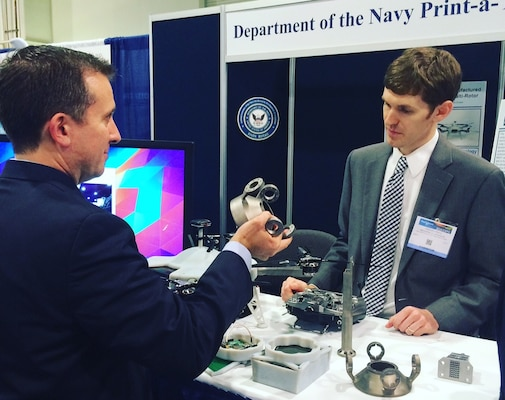 "NATIONAL HARBOR, Md. (May 17, 2016) - Navy engineer Steve Price answers an attendee's question about the small additively manufactured modular payload multi-rotor at the 2016 Sea-Air-Space Expo. This low cost, 3D printed, unmanned aerial vehicle is rapidly adaptable to mission requirements and can accept a wide variety of custom payloads. The UAV was one of the exhibits featured at the Navy Additive Manufacturing Showcase in Dahlgren, Va., last month that were selected for display at the Sea-Air-Space Expo. ""The volume of creative and innovative ideas made feasible with 3D Printing is astounding,"" said Lynn Shoppell, a Naval Surface Warfare Center Dahlgren Division physicist after the Dahlgren showcase. ""The exhibitors demonstrated that their concepts for increased technical capabilities, rapid prototyping, improved logistics operations, and cost reduction initiatives are achievable with 3D Printing. Participants also experimented with additive manufacturing technology research and development."""