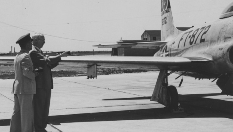 The first flight surgeon in the pioneer Army Air Service of 1918, Dr. Robert J. Hunter, tries out a newfangled noise-measuring gadget on a jet fighter at Randolph Field, Texas. Demonstrating the instrument is Lt. Col. James E. Lett (left), head of the School of Aviation Medicine's Ear-Nose-Throat department, 1959. (Photo courtesy of the National Archives and Records Administration)