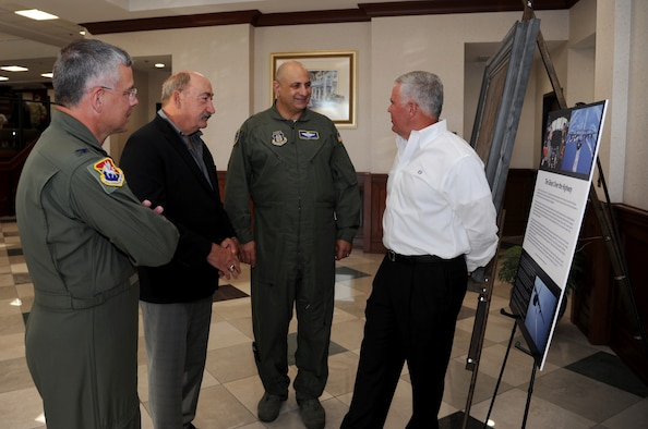 """Retired Col. Jose Davison recounts details of the mission featured by the """"Ghost on the Highway"""" painting with Maj. Gen. Richard """"Beef"""" Haddad, vice commander of the Air Force Reserve Command, retired Master Sgt. Larry Ridge and Col. Randal Bright, 927th Air Refueling Wing commander. All were members of the Reserve's 711th Special Operations Squadron, a subordinate unit of the 919th Special Operations Wing, Duke Field, Florida, during Desert Storm. (U.S. Air Force photo/Tech. Sgt. Peter Dean)"""