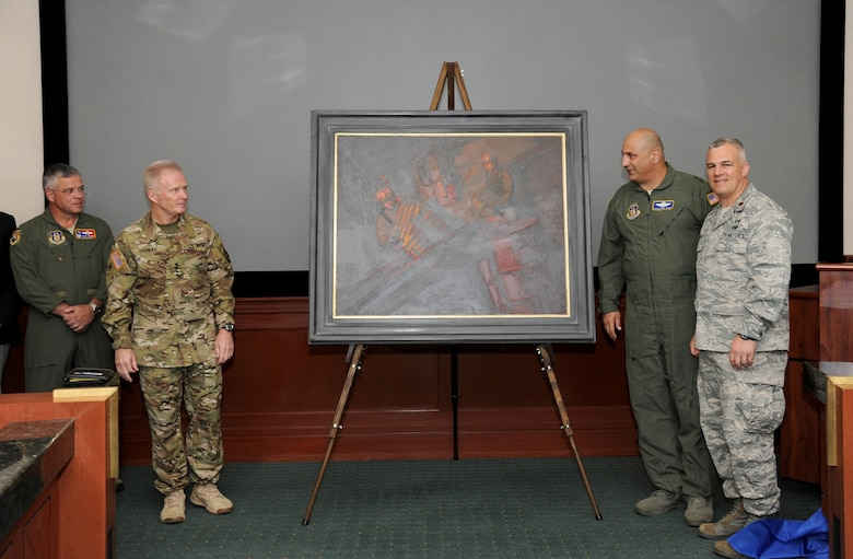 """Gen. Raymond Thomas III, commander of U.S. Special Operations Command, left, and Maj. Gen. Richard """"Beef"""" Haddad, vice commander of the Air Force Reserve Command, admire a painting they unveiled moments earlier titled """"Ghost on the Highway"""" by Maj. Warren Neary during a ceremony May 23 at MacDill Air Force Base, Fla.  Flanking them are Col. Randal Bright, 927th Air Refueling Wing commander, left, and Neary. The event marked the 25th anniversary of Operation Desert Storm during the Retired Special Operations Senior Leader Conference.  (U.S. Air Force photo/Tech. Sgt. Peter Dean)"""