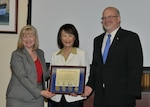 Grace Spence (center) is presented a certificate of appreciation by Maureen Higgins and Philip Hepperle, both of the Defense Contract Audit Agency, May 25, 2016.
