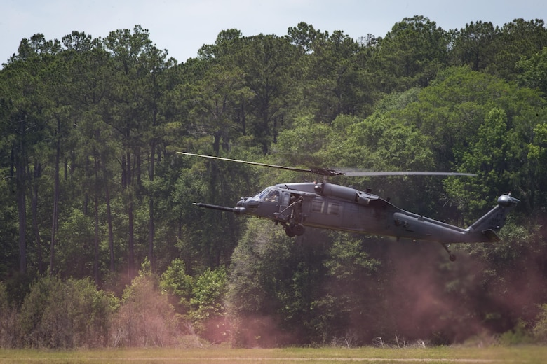An HH-60G Pave Hawk descends to land on Grand Bay Bombing and Gunnery Range at Moody Air Force Base, Ga., May 19, 2016. The Pave Hawk participated in training simulating different combat situations to synchronize efforts between a variety of Air Combat Command airframes. (U.S. Air Force photo by Airman Daniel Snider/Released)