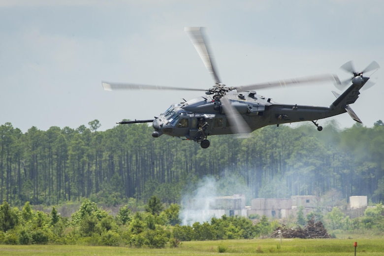 An HH-60G Pave Hawk maneuvers over Grand Bay Bombing and Gunnery Range at Moody Air Force Base, Ga., May 19, 2016. Multiple U.S. Air Force aircraft within Air Combat Command conducted joint aerial training showcasing the aircraft's tactical air and ground maneuvers, as well as its weapons capabilities. (U.S. Air Force photo by Airman Daniel Snider/Released)