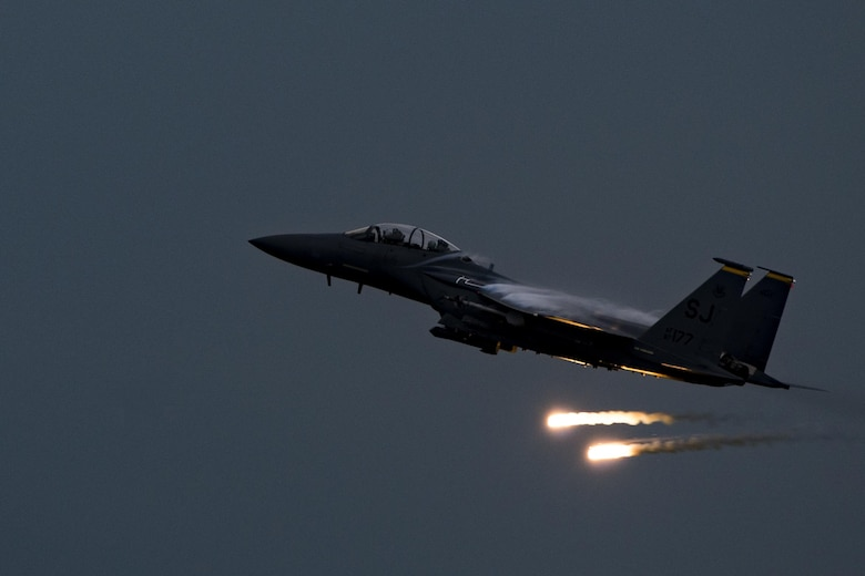 An F-15E Strike Eagle fires flares over Grand Bay Bombing and Gunnery Range at Moody Air Force Base, Ga., May 20, 2016. The F-15 participated in training in which multiple Air Combat Command aircraft conducted tactical air and ground maneuvers. (U.S. Air Force photo by Airman Daniel Snider/Released)