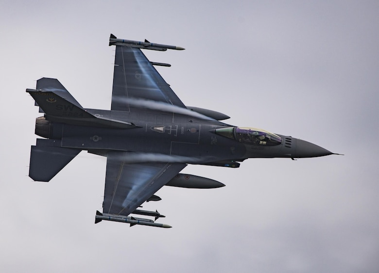 An F-16 Fighting Falcon soars above Grand Bay Bombing and Gunnery Range at Moody Air Force Base, Ga., May 20, 2016. Airmen simulated different combat situations to synchronize efforts between a variety of Air Combat Command airframes. (U.S. Air Force photo by Airman Daniel Snider/Released)