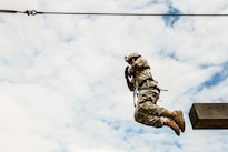 Army Sgt. Christian Hill jumps from an elevated obstacle during the 10th Army Air and Missile Defense Command's 2016 Best Warrior Competition in Baumholder, Germany, May 17, 2016. Air Force photo by Tech. Sgt. Brian Kimball