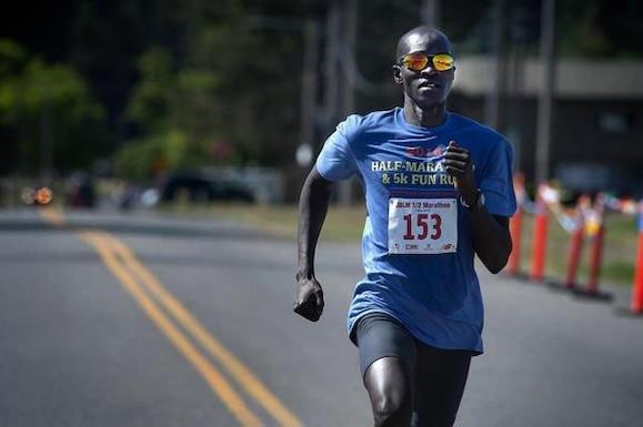 Half-Marathon overall winner Dominic Luka nears the finish line during the JBLM Half-Marathon and 5K Fun Run on Lewis Main May 21.