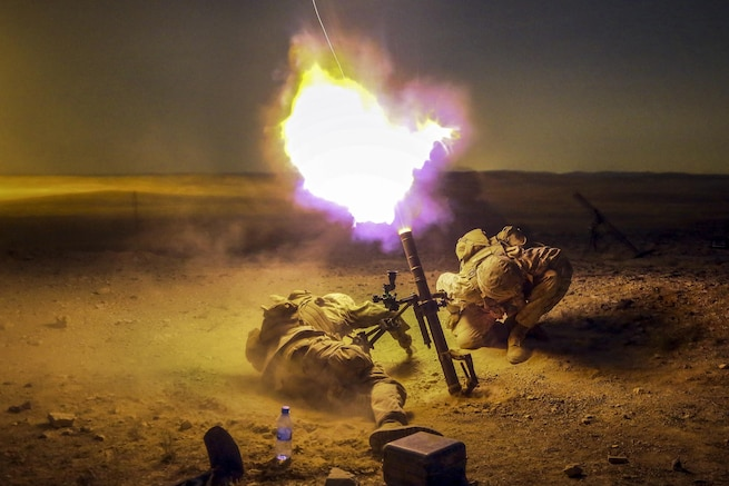 Marine Lance Cpl. Zach King, left, and Cpl. Derick Sammonek brace themselves as a 60mm mortar exits an M224 mortar system during Exercise Eager Lion 2016 in Jordan, May 15, 2016. The exercise enables partner nations to exchange military expertise and improve interoperability. Marine Corps photo by Sgt. Paris Capers