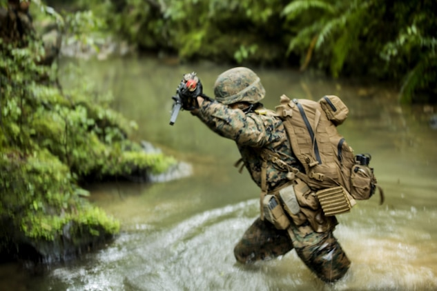 U.S. Marine Pfc. Henry D. Yandell lands in the creek after rappelling off a mountain May 19, 2016 at the Jungle Warfare Training Center, Camp Gonsalves, Okinawa, Japan. Yandell is a combat engineer with 9th Engineer Support Battalion, 3rd Marine Logistics Group, III Marine Expeditionary Force. Yandell and his platoon attended the 5-day Course at JWTC. The course gives Marines the skills to shoot, move and communicate within a jungle environment. (U.S. Marine Corps photo by Lance Cpl. Amaia Unanue/ Released)