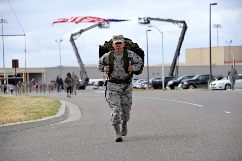 Airman 1st Class Josue Jimenez, 60th Security Forces Squadron, carries a 30-pound rucksack during the Gold Star Families Ruck March at Travis Air Force Base, Calif., May 21, 2016. The ruck march consisted of carrying a 30-pound rucksack for 6.2 miles around the installation. Each rucksack was filled with non-perishable food items which were donated to Mission Solano. (U.S. Air Force photo by Staff Sgt. Charles Rivezzo)