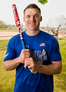 Staff Sgt. John Allen, 319th Communications Squadron high frequency global communications system operations manager, grips a bat during a portrait May 20, 2016, at Roosevelt Park in Devils Lake, N.D. Allen was recently named 2015 Air Force Male Athlete of the Year. (U.S. Air Force photo by Airman 1st Class J.T. Armstrong/Released)