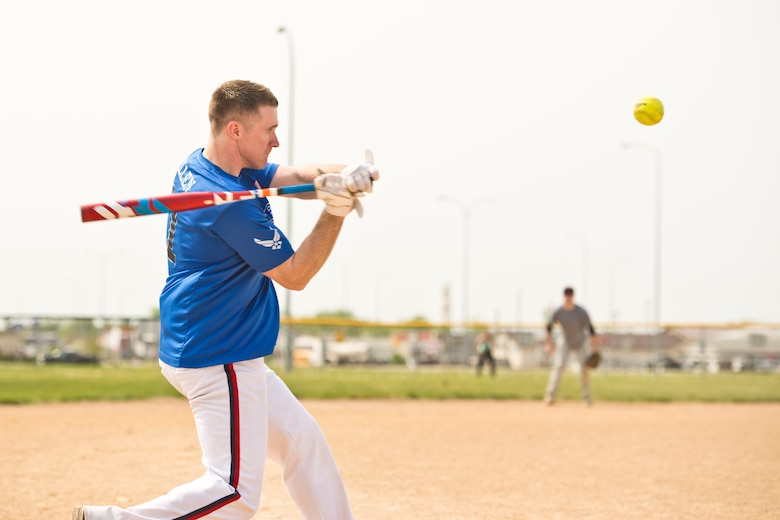 Staff Sgt. John Allen, 319th Communications Squadron high frequency global communications system operations manager, eyes the ball during the second annual Grand Forks Air Force Base vs. Minot AFB softball tournament May 20, 2016, at Roosevelt Park in Devils Lake, N.D. Allen helped lead Grand Forks AFB to an 18-4 victory. (U.S. Air Force photo by Airman 1st Class J.T. Armstrong/Released)