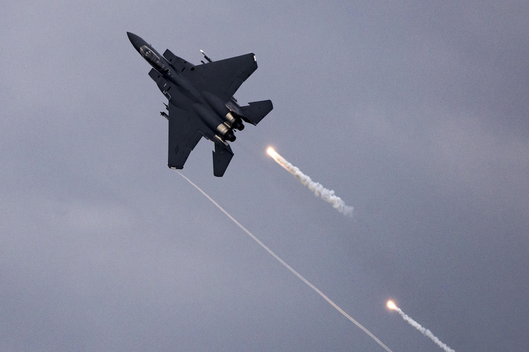 An F-15E Strike Eagle fires flares over Grand Bay Bombing and Gunnery Range at Moody Air Force Base, Ga., May 20, 2016. Airmen simulated different combat and rescue situations to synchronize efforts between a variety of Air Combat Command airframes. (U.S. Air Force photo by Airman Daniel Snider/Released)