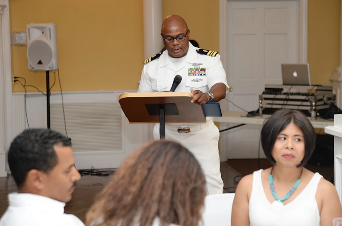 """Lt. Cmdr. Donald Mitchell, senior nurse executive, Naval Branch Health Clinic-Albany, aboard Marine Corps Logistics Base Albany, retires after 30-years of active-duty service in the Navy at a """"fair winds"""" celebration in Orange Park, Florida, May 14. Mitchell kicked-off his own retirement ceremony before a standing-room-only crowd of witnesses, donned in a sea of U.S. Navy summer uniforms and white civilian attire, who poured into the Orange Park Women's Club to celebrate the honoree."""