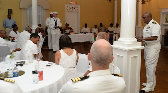 """Lt. Cmdr. Donald Mitchell, senior nurse executive, Naval Branch Health Clinic-Albany, aboard Marine Corps Logistics Base Albany, retires after 30-years of active-duty service in the Navy at a """"fair winds"""" celebration in Orange Park, Florida, May 14. During the event, Mitchell, who kicked-off his own retirement ceremony before a standing-room-only crowd of witnesses, read one rendition of """"Old Glory,"""" and presented American flags to his wife and mother, respectively. Family and friends, donned in a sea of U.S. Navy summer uniforms and white civilian attire, poured into the Orange Park Women's Club to celebrate the honoree."""