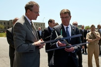 Defense Secretary Ash Carter, right, examines an unmanned aerial vehicle during a visit to the Naval Undersea Warfare Center in Newport, R.I., May 25, 2016. DoD photo by Air Force Senior Master Sgt. Adrian Cadiz