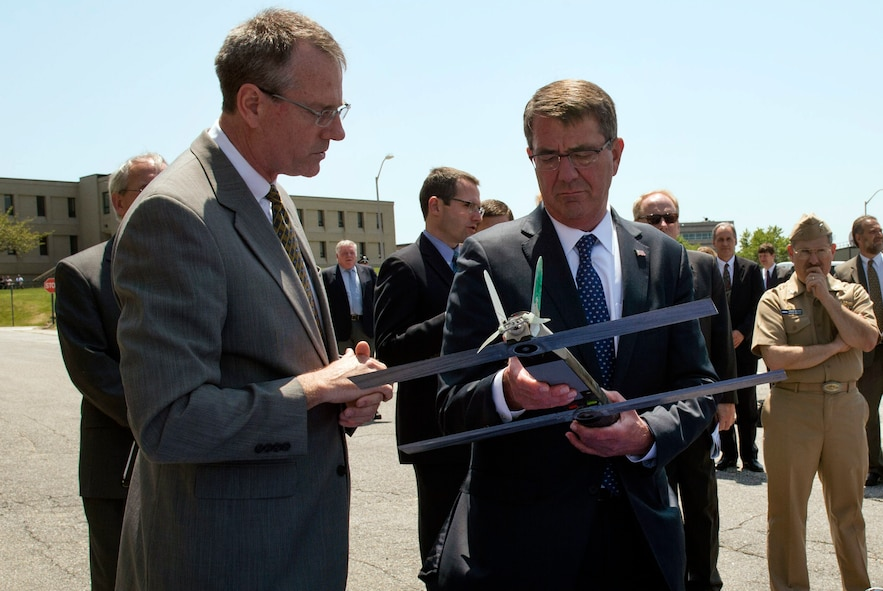 Defense Secretary Ash Carter, right, examining an unmanned aerial vehicle.
