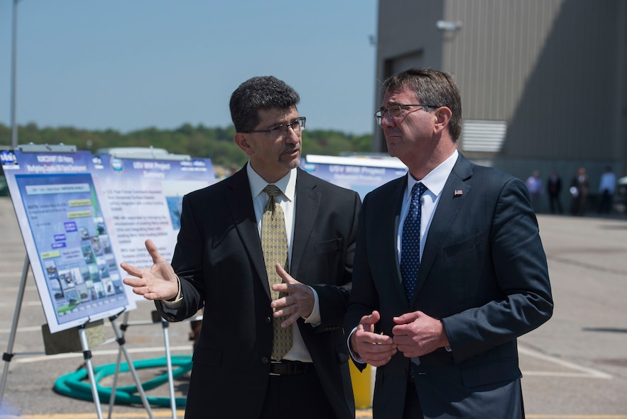 Photo of Defense Secretary Ash Carter, right, receiving a briefing on unmanned surface vehicles from George Maris, a division heat at Naval Undersea Warfare Center.