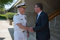 Defense Secretary Ash Carter says goodbye to Navy Rear Adm. P. Gardner Howe III, president of the U.S. Naval War College, after participating in a moderated discussion at the college during a visit to the campus in Newport, R.I., May 25, 2016. DoD photo by Air Force Senior Master Sgt. Adrian Cadiz