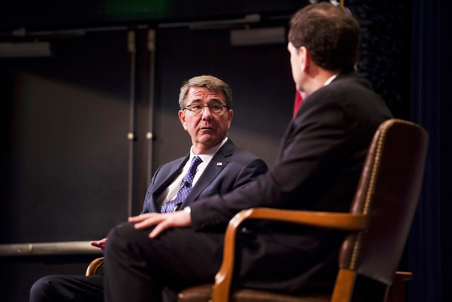 Defense Secretary Ash Carter speaking with Phil Haun, dean of academics at the U.S. Naval War College.