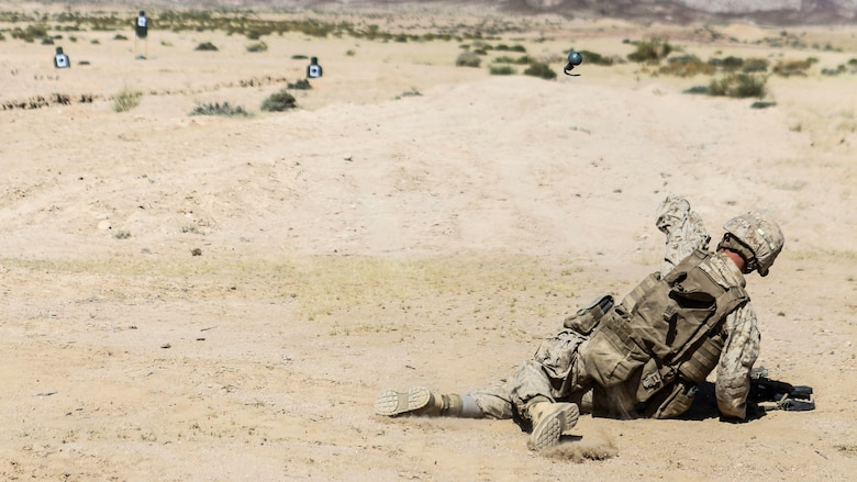 A Marine with 1st Battalion, 2nd Marine Regiment, 2nd Marine Division tosses a training grenade during a squad attacks exercise in Al Quweyrah, Jordan, May 19, 2016. Eager Lion is a recurring exercise between partner nations designed to strengthen military-to-military relationships, increase interoperability, and enhance regional security and stability.