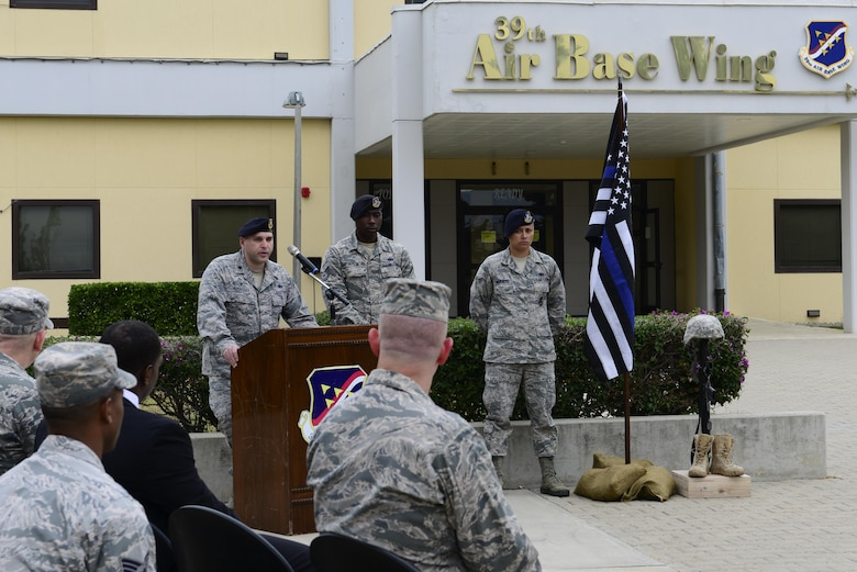U.S. Air Force Lt. Col. Joseph Musacchia, 39th Security Forces Squadron commander, speaks to those in attendance during a National Police Week retreat ceremony May 15, 2016, at Incirlik Air Base, Turkey. Defenders and their counterparts dedicated this time to remember fallen comrades. (U.S. Air Force photo by Staff Sgt. Caleb Pierce/Released)