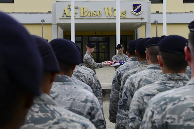 Members of the 39th Security Forces Squadron fold a flag during National Police Week retreat ceremony May 15, 2016, at Incirlik Air Base, Turkey. The folding of the flag concluded the ceremony. (U.S. Air Force photo by Staff Sgt. Caleb Pierce/Released)