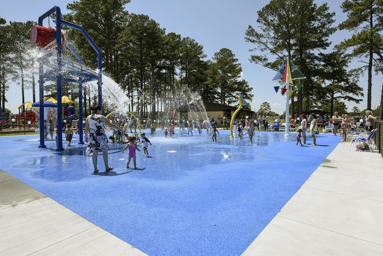 Members of Team Seymour play in the splash pad during the grand re-opening of Debden Park, May 24, 2016, at Seymour Johnson Air Force Base, North Carolina. More than 300 Airmen and their families attended the re-opening event that featured Debden Park's newest addition. (U.S. Air Force photo by Airman Shawna L. Keyes/Released)