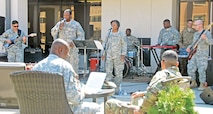 The 1st Infantry Division Band plays as Soldiers listen and eat their lunch during the Jazz Appreciation Month luncheon at the Soldier and Family Assistance Center April 13.