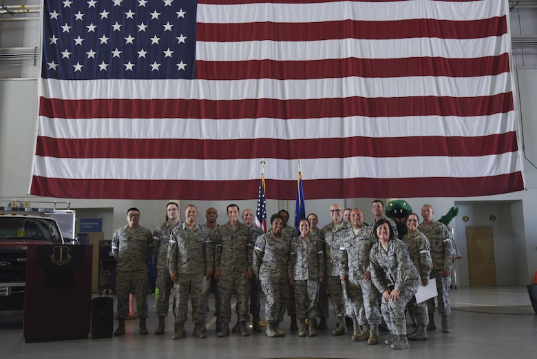 Master sergeant selects stand for a group photo at the Louis F. Garland Department of Defense Fire Academy on Goodfellow Air Force Base, May 25, 2016. Each promotee has earned the rank of master sergeant by passing all required fields. (U.S. Air Force photo by Airman 1st Class Chase Sousa)