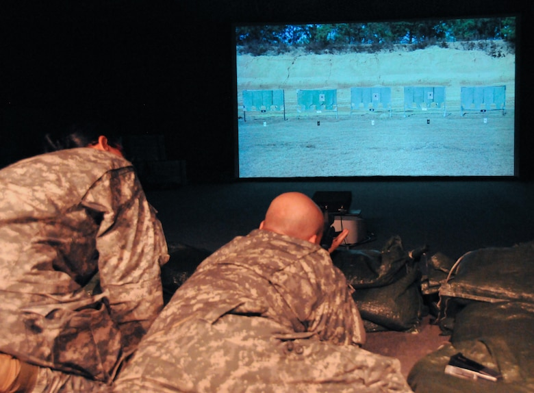 Soldiers of the Army Reserve's 99th Regional Support Command practice rifle marksmanship using the Engagement Skills Trainer, a virtual rifle range that allows Soldiers to practice shooting in a video game-style environment without expending actual rounds.