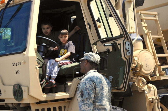 A child tries out an Army M1142 Tactical Fire Fighting Truck belonging to the 482nd Engineer Detachment (Firefighting) during the Milwaukee Armed Forces day event in Milwaukee, May 21.