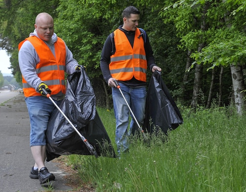 Volunteers pick up trash during an off-base clean-up event May 20, 2016, at Ramstein Air Base, Germany. These efforts are one of many ways Team Ramstein assists in ensuring Ramstein and its surrounding areas stay in top shape. (U.S. Air Force photo/Senior Airman Larissa Greatwood)