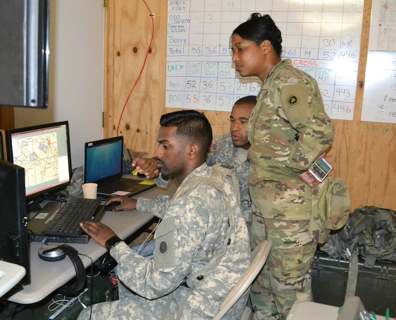 Col. Toni Glover, 650th Regional Support Group commanding officer, is briefed on the 314th Combat Sustainment Support Command's communications network at Fort Polk during Joint Readiness Training Center exercises May 7, where units from the U.S. Army National Guard, Army Reserve and active-duty Army train together.