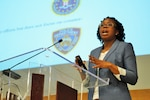 Kemisha D. Sherrell, a fellow at the National Defense University's College of International Security Affairs, presents her thesis on assessing U.S. strategies to counter violent radicalization during the college's thesis symposium, May 24, 2016. Courtesy photo