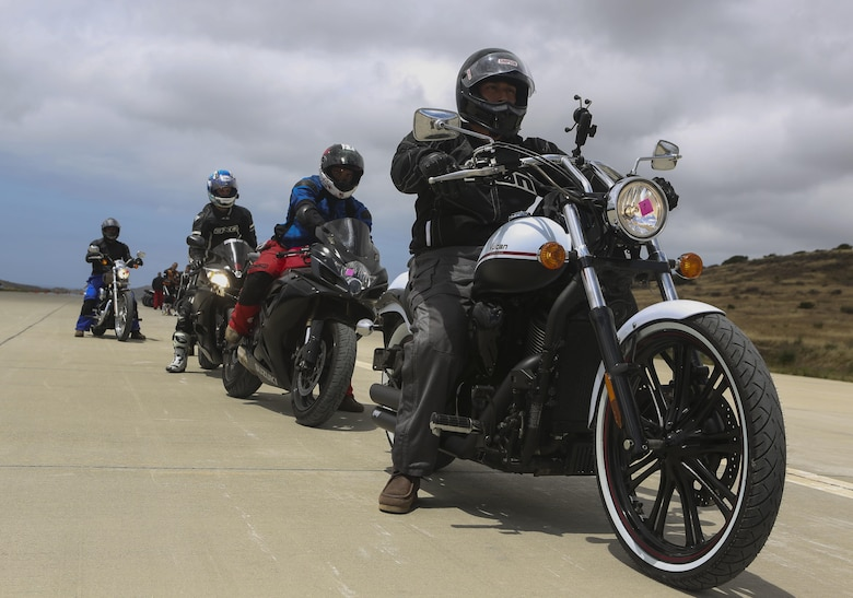Service members with 3rd Marine Aircraft Wing wait in line to participate in the quick stop and body positioning workshops on the helicopter landing field turned motorcycle track during Motorcycle Rider Preservation Day 2016 in San Mateo Canyon, on Marine Corps Base Camp Pendleton, Calif., May 20. Marine Aircraft Group 39 partnered with Marine Corps Base Camp Pendleton Motorcycle Safety Division to host Motorcycle Rider Preservation Day 2016 for 3rd MAW service members who own bikes. (U.S. Marine Corps photo by Lance Cpl. Harley Robinson/Released)