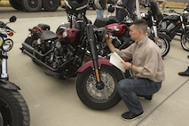 Maj. Aaron Milroy, director of safety and standardization for MAG-39, conducts inspections on the motorcycles during Motorcycle Rider Preservation Day 2016 in San Mateo Canyon on Marine Corps Base Camp Pendleton, Calif., May 20. Marine Aircraft Group 39 partnered with Marine Corps Base Camp Pendleton Motorcycle Safety Division to host Motorcycle Rider Preservation Day 2016 for 3rd Marine Aircraft Wing service members who own bikes. (U.S. Marine Corps photo by Lance Cpl. Harley Robinson/Released)