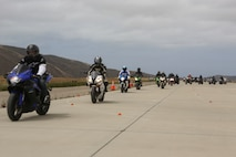 Service members with 3rd Marine Aircraft Wing ride on the helicopter landing field turned motorcycle track during Motorcycle Rider Preservation Day 2016 in San Mateo Canyon on Marine Corps Base Camp Pendleton, Calif., May 20. Marine Aircraft Group 39 partnered with Marine Corps Base Camp Pendleton Motorcycle Safety Division to host Motorcycle Rider Preservation Day 2016 for 3rd MAW service members who own bikes. (U.S. Marine Corps photo by Lance Cpl. Harley Robinson/Released)