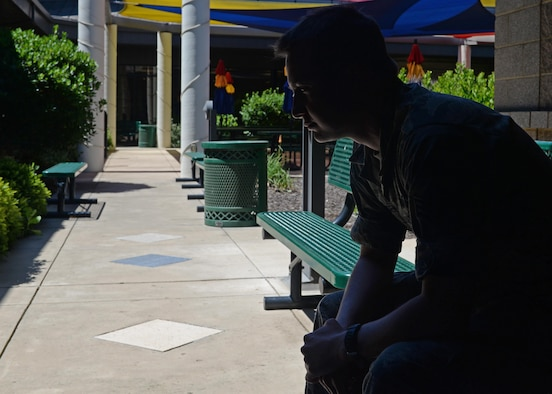 An Airman simulates contemplating about the stressors of military life and how it can affect his career May 25, 2016, at Beale Air Force Base, California. The Military Family Life Consultant (MFLC) are master or Ph.D. level professionals who are experienced social workers, psychologists and marriage and family therapists. They provide free brief counseling services to active duty airmen and their loved ones, which is confidential. However, if there is any safety concerns of harm to self or others, the MFLC is required to transition the individual to Mental Health, Family Advocacy or Chapel Corps. (U.S. Air Force photo by Senior Airman Ramon A. Adelan)