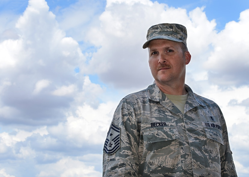 SMSgt Bradley Becker, 9th AMXS, First Sergeant, poses for a photo at Beale Air Force Base, California. (U.S. Air Force photo by Robert Scott)