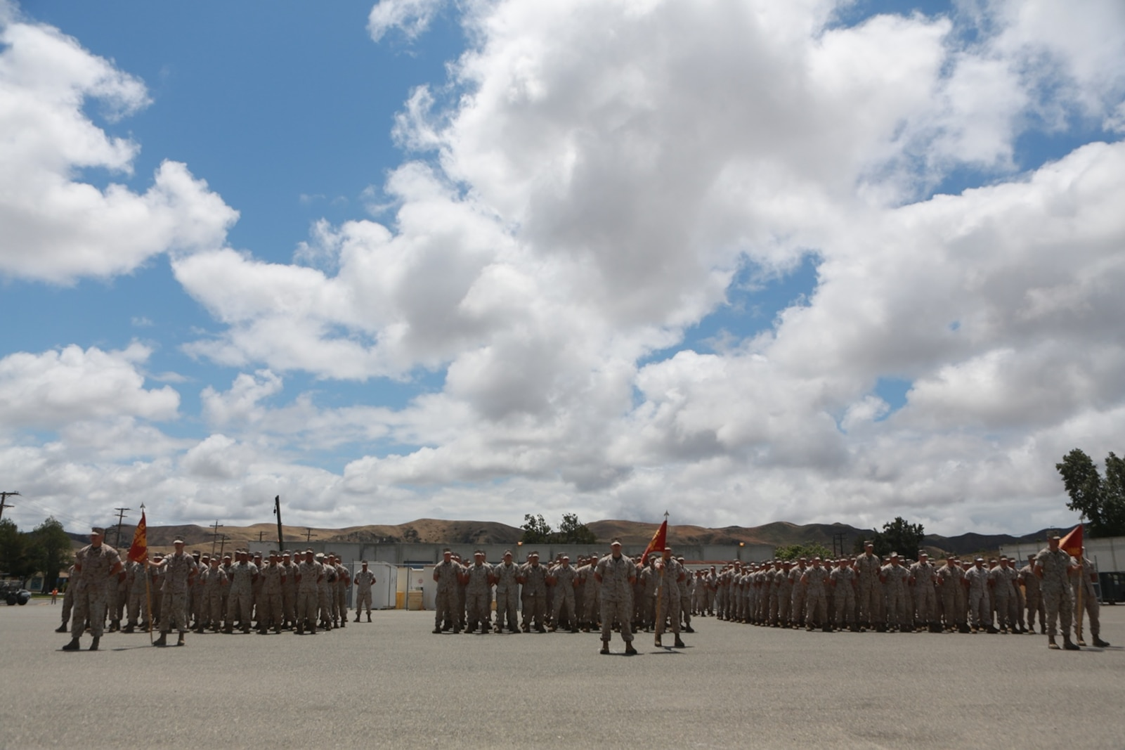 U.S. Marines with 1st Maintenance Battalion, Combat Logistics Regiment 15, 1st Marine Logistics Group await the arrival of Gen. Robert Neller Commandant of the Marine Corps, on Camp Pendleton, Calif., May 24, 2016. Gen. Neller addressed the future of the Marine Corps and answered questions from the Marines. (U.S. Marine Corps photo by Sgt. Rodion Zabolotniy, Combat Camera, Camp Pendleton/RELEASED)
