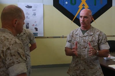 U.S. Marine Corps Brig. Gen. David Ottignon, commanding general, 1st Marine Logistics Group  talks with Gen. Robert Neller, Commandant of the Marine Corps, about the current and future 3D printing operations using the Expeditionary Manufacturing System within the 1st MLG on Camp Pendleton, Calif., May 24, 2016. The Expeditionary Manufacturing System is a mobile 3D printing and milling shop designed to provide quick turnaround for mission critical parts in deployed environment. (U.S. Marine Corps photo by Sgt. Rodion Zabolotniy, Combat Camera, Camp Pendleton/RELEASED)